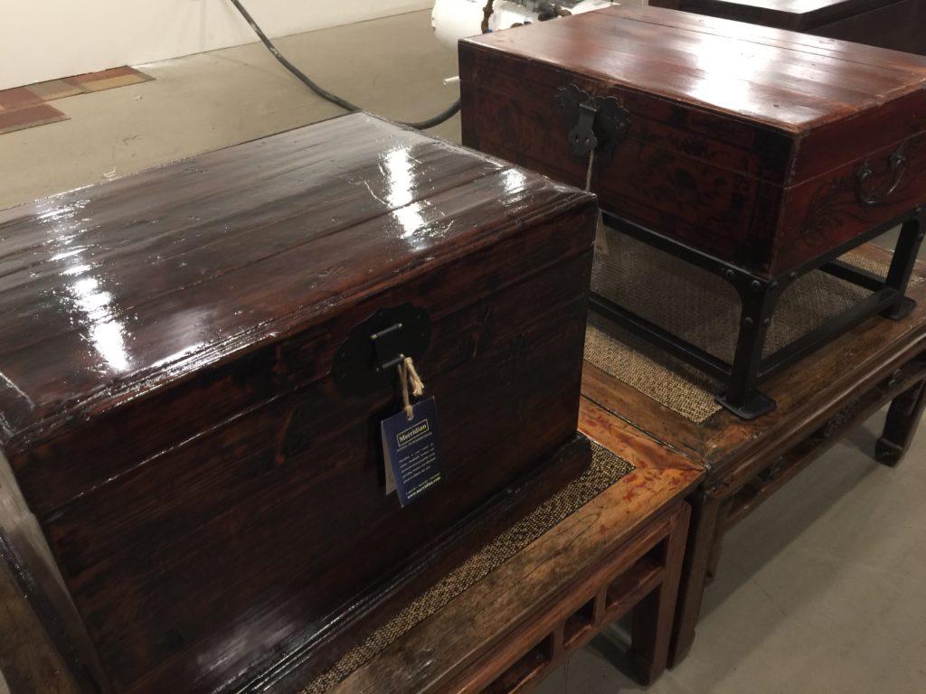 Two dark wooden chests, high design.