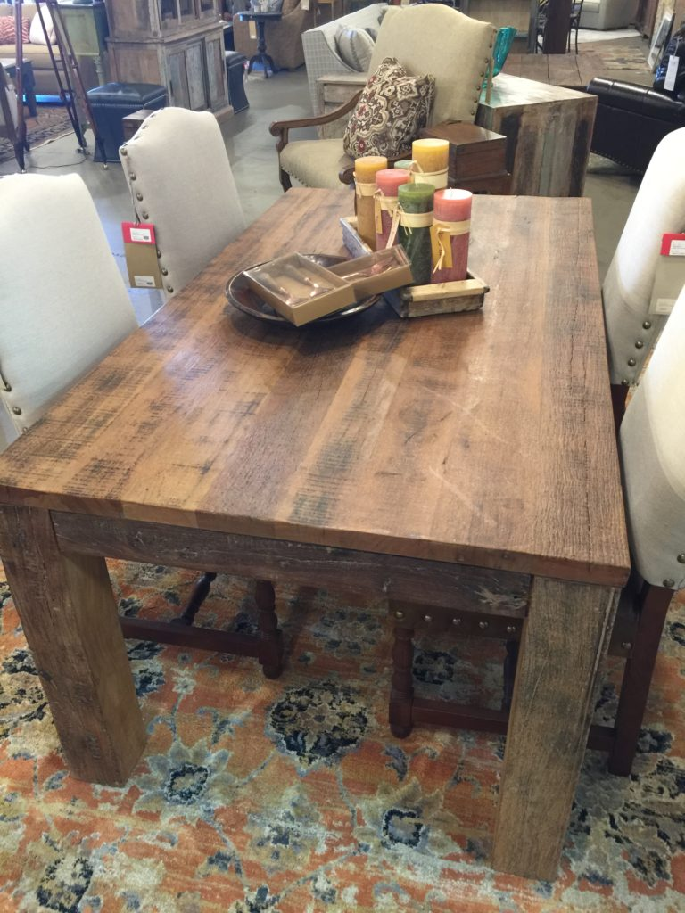 Rustic Wooden Table with thick posts for legs.