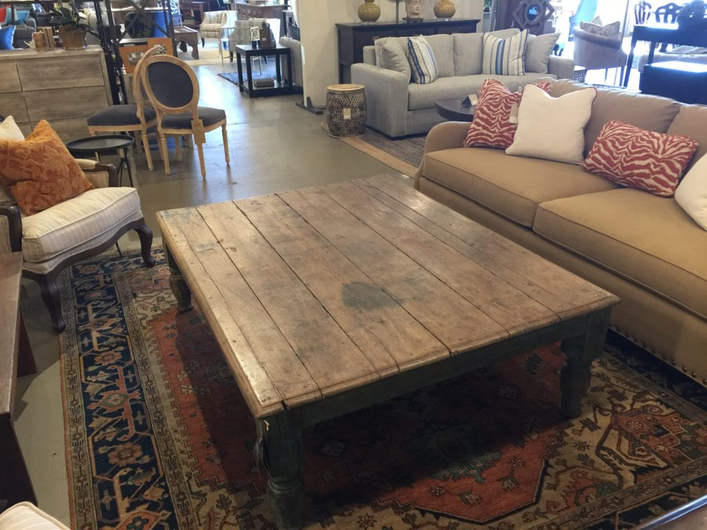 Low and wide this wooden coffee table makes a statement.